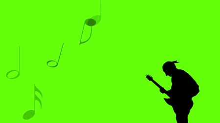rock music : Silhouette - Musician playing guitar and music flying. Green screen Stock Footage