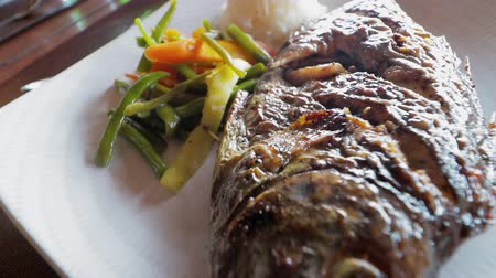 SLOW MOTION: Grilled fish with curry sauce Stok Video