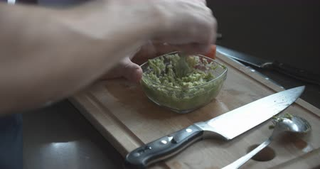 Mashing Avocado With Fork In Bowl Stok Video