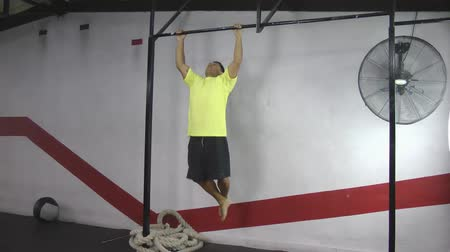 çekme : Athlete making strict pull ups crossfit exercise Stok Video