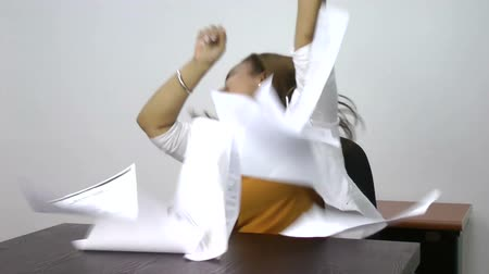 sucessful : Woman winning dancing celebrating her success excited tossing papers in the air at her office. Beautiful african model Stock Footage