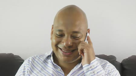 braces smile : Businessman using a mobile phone at home Stock Footage