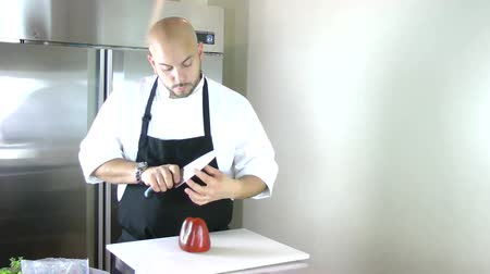 mutfak malzemesi : Chef testing the knife in the kitchen. Timelapse Stok Video