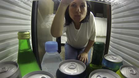 přední : woman opening the fridge. Taking something to drink very happy Dostupné videozáznamy