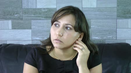 решение : Young pensive female businesswoman looking sideways