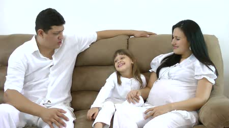 parenthood : happy family on the couch