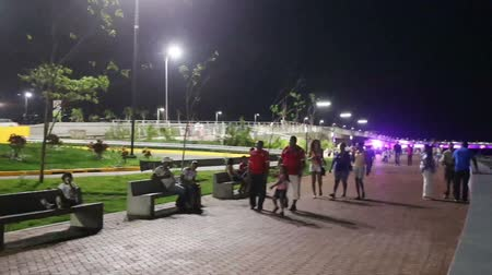 bola : PANAMA CITY, PANAMA - MAY 11: Many tourist walking in the third stage of Cinta Costera in the night on Panama City, Panama in May 11, 2014.