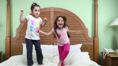 jump : Girls jumping in the bed Stock Footage