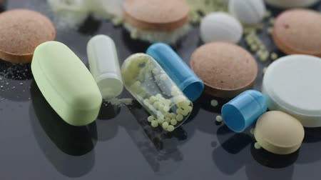 drug : Drug Addiction Concept. Macro film of powder by open pills.  Stock Footage