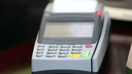 sürgülü : close up image of a credit card being swiped through a card machine.
