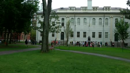 cambridge : Timelapse of many people visiting the Harvard University Campus. Harvard had been ranked the Academic Ranking of World Universities and World Reputation Rankings since the time when they were released