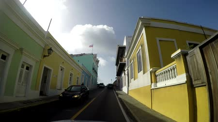 spanish style : SAN JUAN, PUERTO RICO, AUG 1: POV of Old narrow brick paved road and colonial houses in the old city of San Juan, Puerto Rico on Aug 1, 2017. Old San Juan is a main spot for local and internal tourism