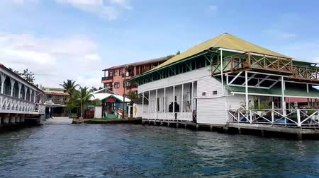 bungaló : BOCAS DEL TORO, PANAMA, NOV 6, 2017: Shoreline of Bocas Town with hotels, restaurants, and water taxis, Bocas del Toro, Panama in Bocas del Toro, Panama on Nov 6, 2017. Stock mozgókép