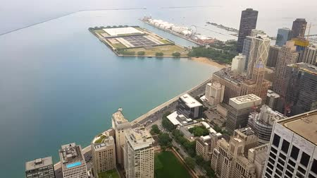 within : View of the city of Chicago and lake Michigan. Lake Michigan is one located entirely within the United States.