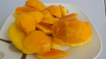manga : Close up of Mangoes in slice cube on a plate.