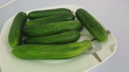 Close up of many cucumbers in a plate. Vídeos