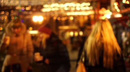ярмарка : People visit Christmas Fair in old town at evening. Defocused