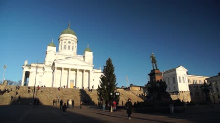 evangelical : HELSINKI, FINLAND - DECEMBER 27, 2015: Tourists visit Cathedral at daytime on December 27, 2015 in Helsinki, Finland