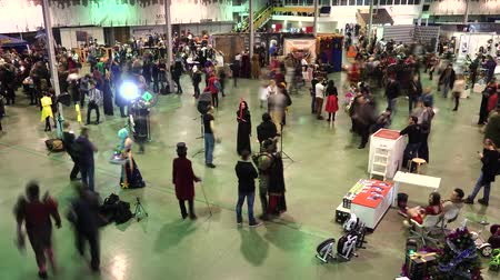 kiállítási tárgy : Moscow, Russia - November 19, 2016: People attend the Gamefilmexpo festival dedicated to video games, TV series and comics, anime, manga, cosplay. Time-lapse