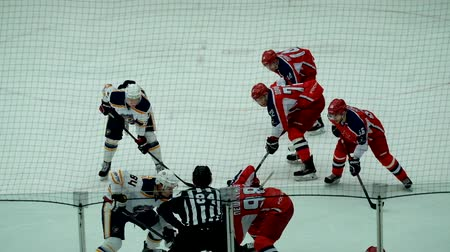 háttérrel : Chekhov, Russia - January 7, 2016: Hockey match between the teams Zvezda (Chekhov) and Orsk (Southern Urals) in Vityaz Ice Palace. Zvezda wins 4:2 Stock mozgókép