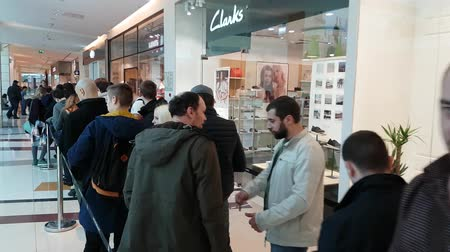 busy line : Moscow, Russia - April 1, 2017: Buyers stand in line waiting for the opening of DJI Authorized Store