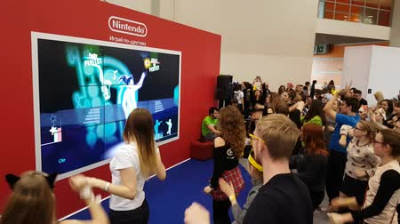 экспозиция : Moscow, Russia - April 23, 2017: Visitors testing Nintendo dancing video game at Hinode Power Japan festival