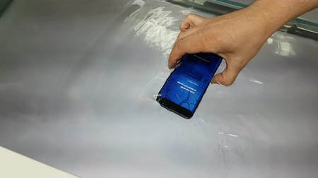 interactive table : Moscow, Russia - June 11, 2017: Underwater demonstration of a new Galaxy S8 smartphone in the Samsung brand store
