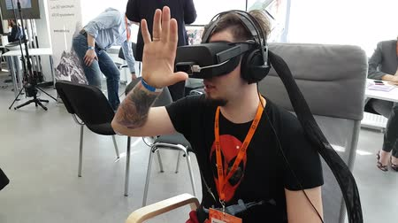 event : Moscow, Russia - June 8, 2017: VR conference visitor tests virtual reality helmet