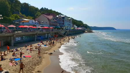 morze bałtyckie : Svetlogorsk - Russia, July 12, 2017: People relax and sunbathing at Baltic Sea shore at sunny summer day Wideo
