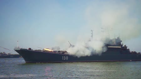 torpedo : Baltijsk, Russia - July 30, 2017: Military naval ship firing rockets during a parade to the day of the Russian Navy. Slow motion
