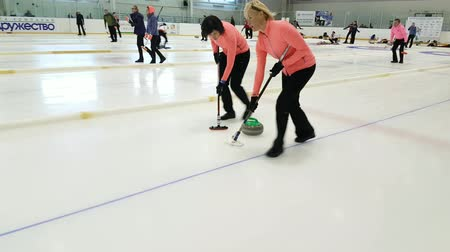 yarışma : Svetlogorsk, Russia - August 5, 2017: Team members play in curling during IX international Medexpert Curling Cup Stok Video