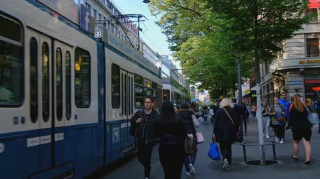 tramwaj : Zurich, Switzerland - May 3, 2018: People and city transport at Bahnhofstrasse at the morning time Wideo