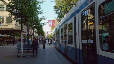 bahnhof : Zurich, Switzerland - May 3, 2018: People and city transport at Bahnhofstrasse at the morning time Stock Footage