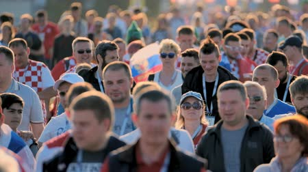 fan zone : Kaliningrad - Russia, June 16, 2018: Football fans support teams on the streets of the city on the day of the match between Croatia and Nigeria Stock Footage