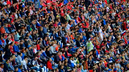 excitação : Kaliningrad - Russia, June 22, 2018: Football fans support teams on the match between Serbia and Switzerland
