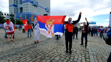 sérvia : Kaliningrad - Russia, June 22, 2018: Football fans support teams on the street of the city on the day of the match between Serbia and Switzerland