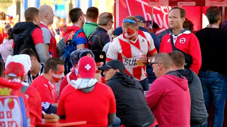 fan zone : Kaliningrad - Russia, June 22, 2018: Football fans support teams on the street of the city on the day of the match between Serbia and Switzerland