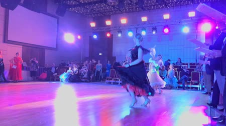 ballroom : Moscow - Russia, March 10, 2018: Girls wearing colourful dresses take part in dance competitions. Slow motion