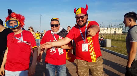 fan fest : Kaliningrad - Russia, June 28, 2018: Football fans support teams on the street of the city on the day of the match between England and Belgium Stock Footage