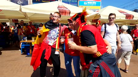 league : Kaliningrad - Russia, June 28, 2018: Football fans support teams on the street of the city on the day of the match between England and Belgium Stock Footage