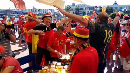 fan zone : Kaliningrad - Russia, June 28, 2018: Football fans support teams on the street of the city on the day of the match between England and Belgium Stock Footage