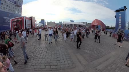 fan zone : Kaliningrad - Russia, May 28, 2018: Football fans attend stadion Kaliningrad before match between England and Belgium. Motion time lapse