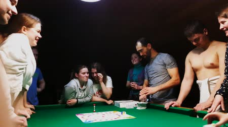 více : Moscow, Russia - November 19, 2017: People playing alias game at the party on the pool table