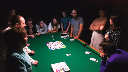 mais : Moscow, Russia - November 19, 2017: People playing alias game at the party on the pool table