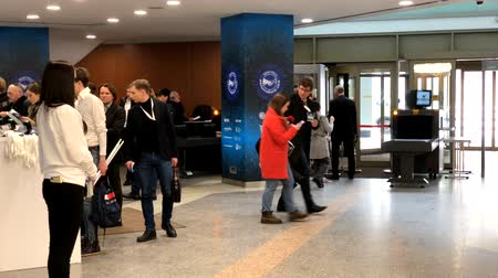 trade fair : Moscow, Russia - March 27, 2018: Visitors of business conference check-in in registration deck