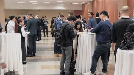 socializing : Moscow, Russia - March 27, 2018: Visitors of business conference having coffee break