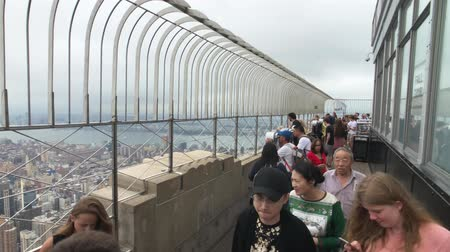 observation deck : New York, USA - September 6, 2018: Visitors observing Manhattan cityscape at Empire State building observation deck