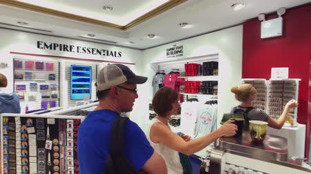 dar : New York, USA - September 6, 2018: Visitors choosing souvenirs at Empire State building gift shop
