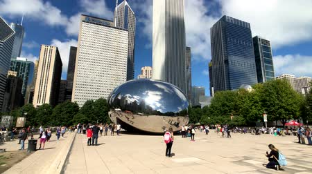 millennium : Chicago, USA - September 6, 2018: Tourists visiting the city landmark sculpture. Cloud Gate is a public sculpture by Indian-born British artist Sir Anish Kapoor