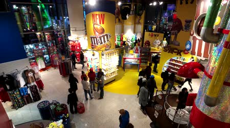mms : New York, USA - September 6, 2018: M&MS World Candy Store in Times Square interior Stock Footage